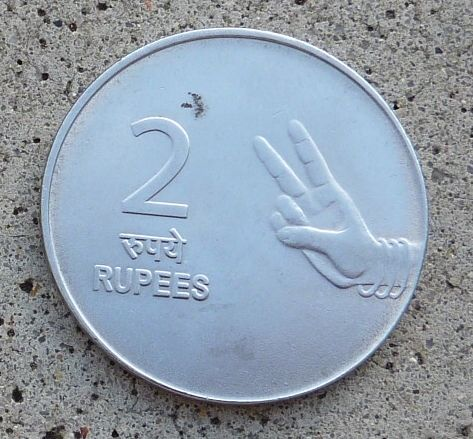 2 rupee coin shows image of two fingers as well as the number 2